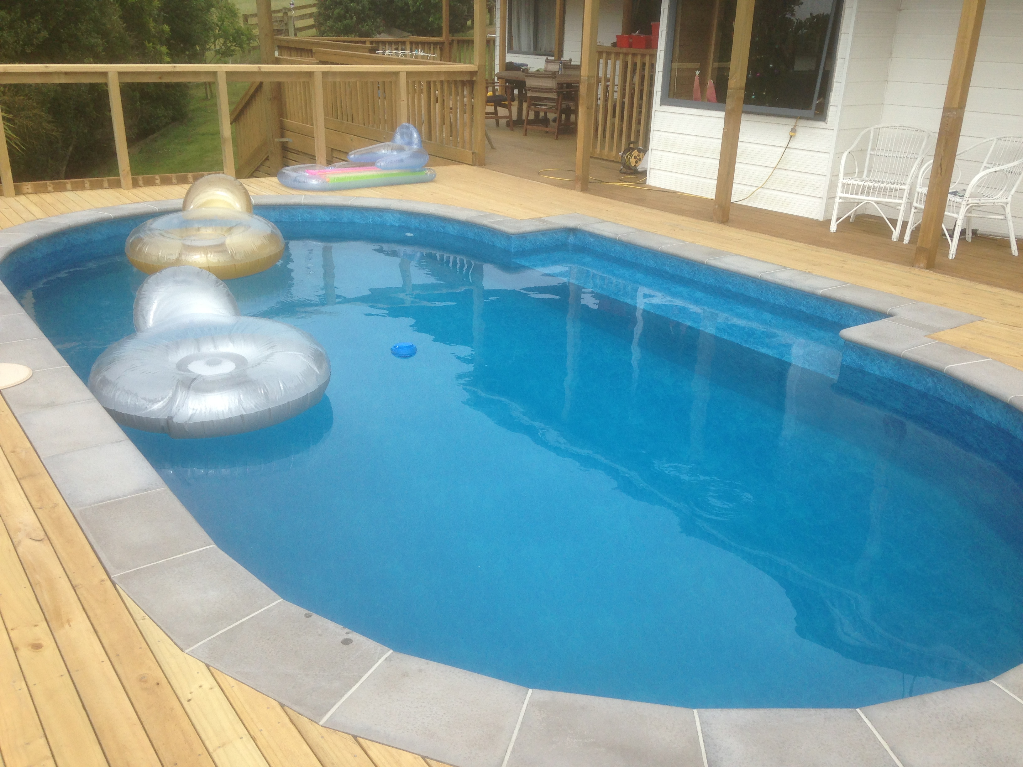 Swimming Pool On A Sloping Site Raised Up Out Of The Ground